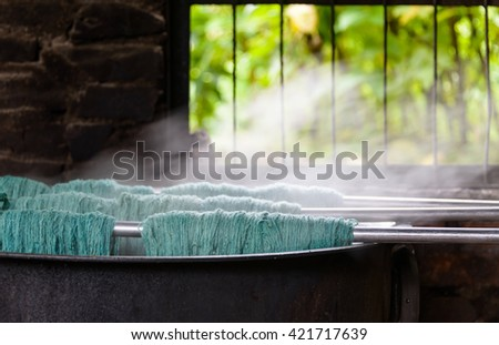 Natural wool dyeing in a carpet factory, Nepal - stock photo