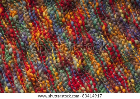 natural wool fabric with colorful hand made - stock photo