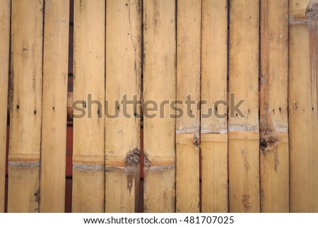 Natural yellow dry bamboo wall,gate for background.