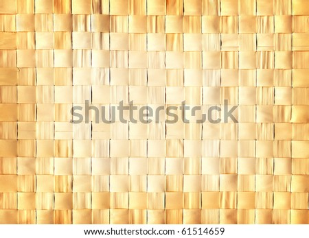 Natural yellow gold background wattled from dried leaves - stock photo