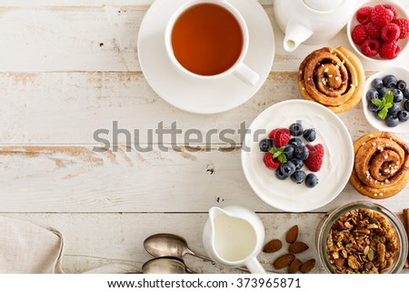 Natural yogurt in a bowl with fresh berries for breakfast - stock photo