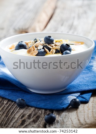 Natural yogurt with fresh blueberries, selective focus