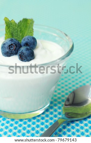 Natural yogurt with fresh blueberry and mint leave