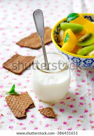 natural yogurt with fruit salad and crisp bread. selective focus - stock photo