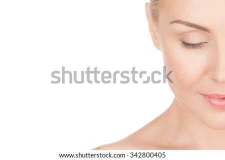 Naturally beautiful. Cropped closeup portrait of a beautiful mature woman smiling with her eyes closed - stock photo