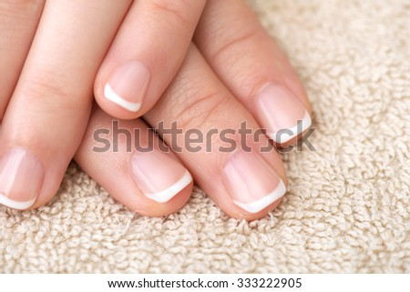 Naturally French Manicured Fingernails healthy hand - stock photo