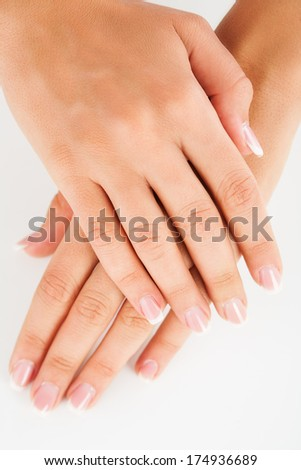 Naturally Manicured Fingernails with manicure tools and cream