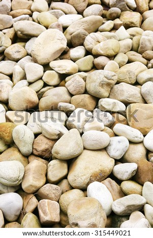 Naturally polished rock pebbles. for background. - stock photo