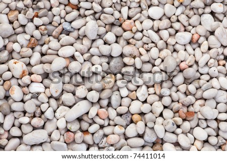 Naturally rounded gravel at sea shore. Nature background texture pattern. - stock photo