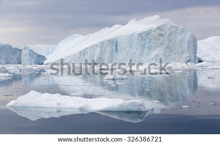 Nature and landscapes of Greenland. Travel on the scientific vessel among ices. Studying of a phenomenon of global warming. Ices and icebergs of unusual forms and colors. - stock photo