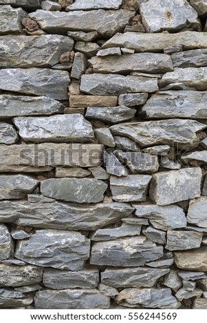 nature background of stone wall with different size and color