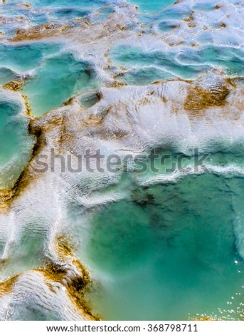 Nature background - white travertines with turquoise water. Thermal springs in spa resort Pamukkale - natural reserve in Turkey. - stock photo