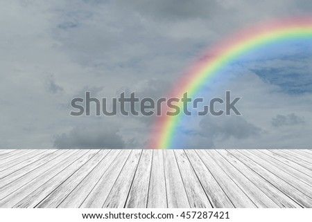 Nature cloudscape with blue sky and white cloud with Wood terrace and rainbow - stock photo