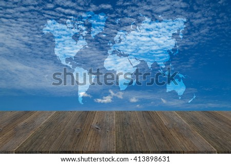 Nature cloudscape with blue sky and white cloud with Wood terrace and world map - stock photo
