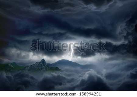 Nature force background - bright lightning in dark stormy sky in mountains - stock photo