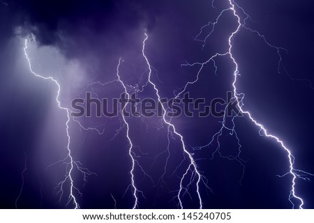 Nature force background - dark stormy sky with lightnings - stock photo