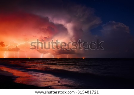 Nature force background - lightning in dark sky, sea - stock photo