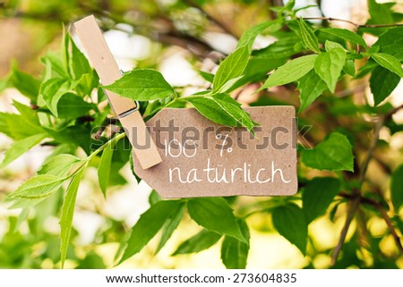 nature greeting card background - german for hundred percent natural - stock photo