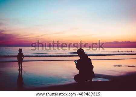 Nature in twilight period. Sunrise or Sunset over the sea. Sea view from tropical beach with purple sky. Summer beach with blue sea water and purple sky. Sea scape scene with sunset landscape.