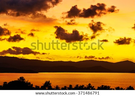Nature Landscape. Scenic View Of Tropical Island Coast During Orange Sunset Over Sea With Beautiful Sky And Clouds. Scenery Background. Coastline. Travel On Summer Vacations To Thailand. Tourism - stock photo
