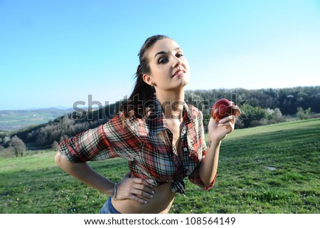nature lover eats a good apple - stock photo