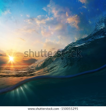 Nature marine design postcard. beautiful colored breaking surfing ocean wave rolling down at sunset time - stock photo
