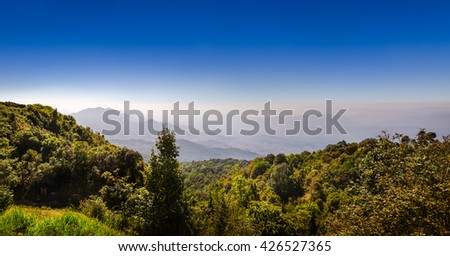 Nature. Mountain forest landscape under sunlight with heavy blue sky scenery. Nature forest landscape. Mountain forest landscape view.  Thailand landscape - stock photo