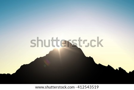 nature, mountaineering and alpinism concept - silhouette of mountain top over sky and sun light background - stock photo