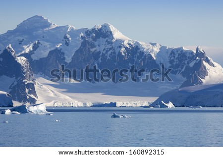 Nature of Antarctic Peninsula. Glaciers and icebergs. Travel on deep pure waters among ices of Antarctica. Fantastic snow landscapes.
