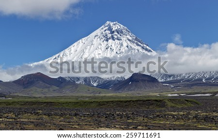 Nature of Kamchatka - beautiful volcanic landscape: view on high stratovolcano correct form - stock photo