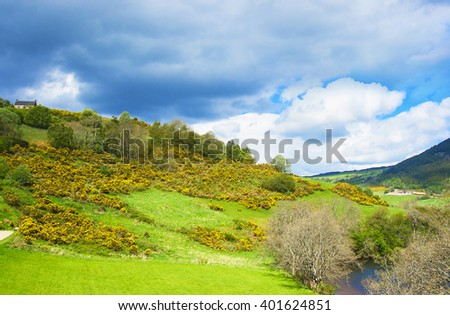 Nature of Loch Ness in Scotland. Loch Ness is a city in the Highlands in Scotland in the United Kingdom. - stock photo