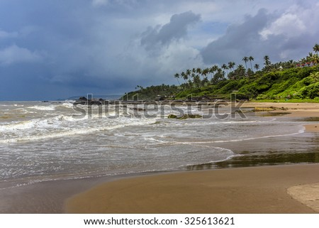 Nature of Vagator - wonderful red cliffs, palm trees, admirable Arabian Sea and golden sand. Vagator Beach - one of busiest places and tourist attraction places of rest. Bardez Taluka, Goa.