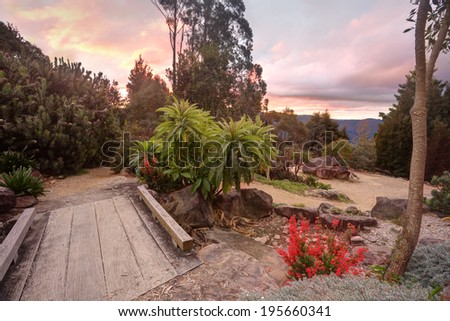 Nature path meandering through the beautiful and tranquil Blue Mountains, NSW Australia at sunset - stock photo