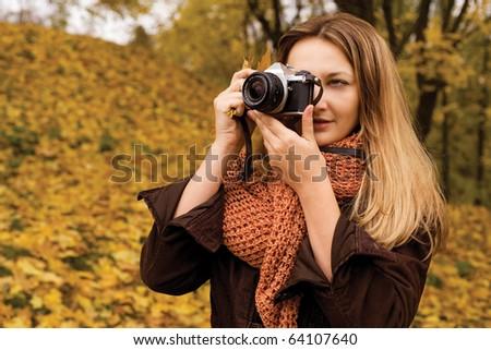 Nature photographer at work - stock photo