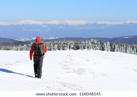 Nature photographer trekking in the mountains - stock photo