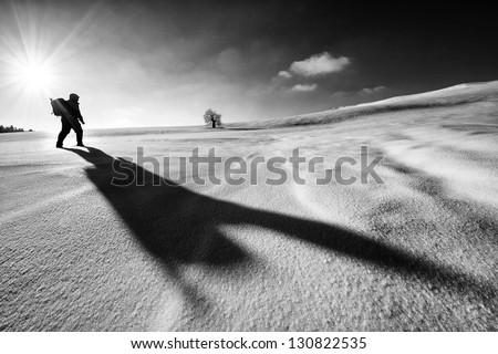 Nature photographer trekking in winter season - stock photo