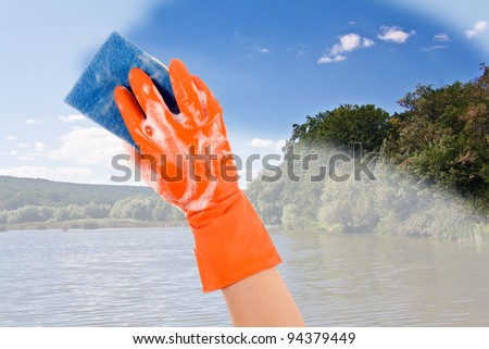 Nature's hand in a glove cleans dirt nature - stock photo
