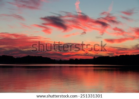 Nature's wonderful colors after the sunset on a lake front - stock photo