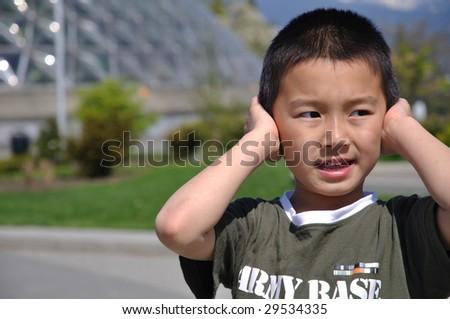 naughty boy refuse to hear - stock photo