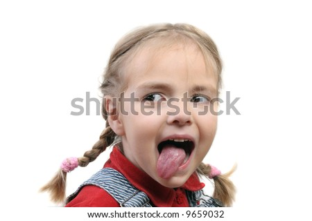 naughty child showing her tongue