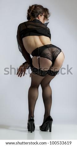 Naughty schoolteacher in black lingerie - stock photo