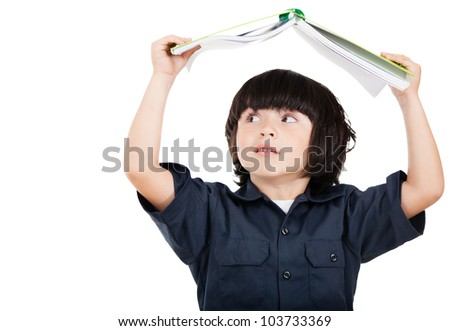 Naughty student playing with a notebook - isolated ober white