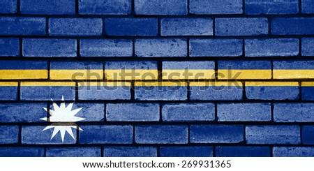 Nauru flag painted on old brick wall texture background - stock photo