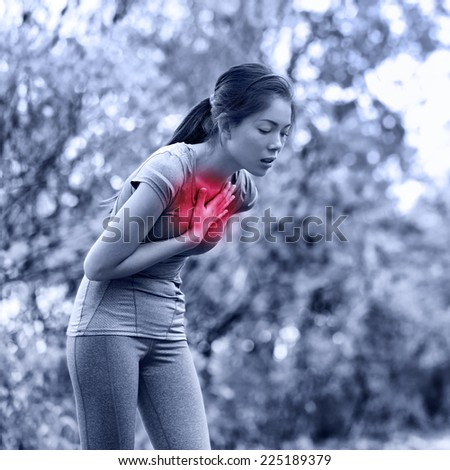 Nausea - nauseous and sick ill runner vomiting. Running woman feeling bad about to throw up. Girl having nausea from dehydration or chest pain. - stock photo