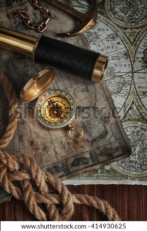 Nautical background with a navigation tools: telescope, compass and old map - stock photo