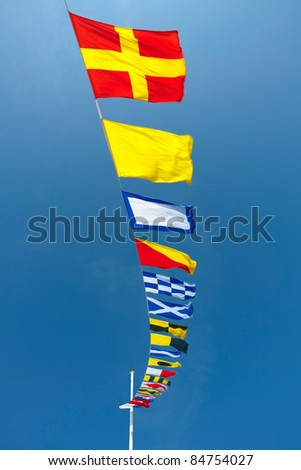 Nautical Flags Colorful Nautical Flags Flying - stock photo