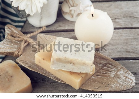Nautical SPA Background. Organic soap and spa treatments on old wooden background