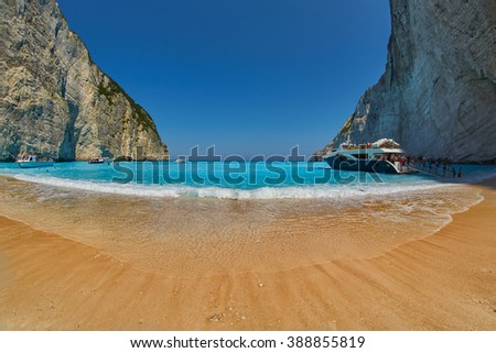 NAVAGIO BAY, ZANTE/GREECE - JUNE 2015: Pirate's Bay with Sandy Beach and Tourist Ships in Zakinthos Island of Greece - stock photo