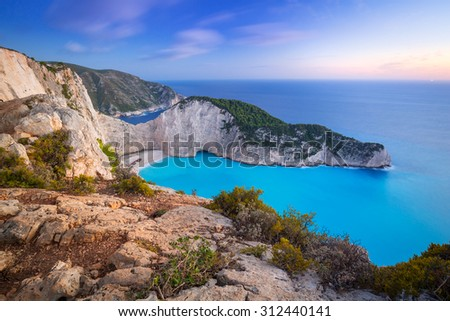 Navagio Beach (Shipwreck beach) on Zakynthos Island at sunset, Greece - stock photo