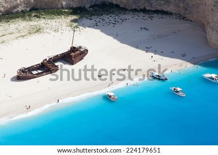 Navagio beach with sailboats in Zakynthos Island, Greece, part of Ionian Islands - stock photo